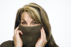 Woman behind turtleneck Stock Image