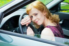 A woman behind the wheel Stock Images