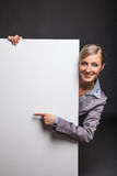Woman behind white banner Stock Photos