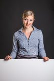 Woman behind white banner Royalty Free Stock Photos