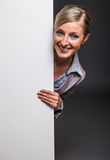 Woman behind white banner Stock Photography