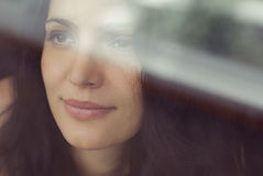 Woman behind the window. Beautiful woman looking for a window Stock Photography