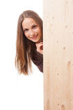 Woman behind a wooden board Royalty Free Stock Images