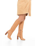 Woman in beige autumn boots Royalty Free Stock Images