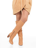 Woman in beige autumn boots Royalty Free Stock Image