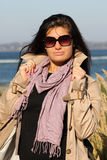 Woman in beige autumn coat standing at beach Royalty Free Stock Photos