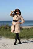 Woman in beige autumn coat and sunglasses Stock Images
