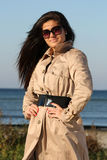 Woman in beige autumn coat and sunglasses Royalty Free Stock Photography