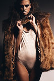 Woman in beige body and fur coat Royalty Free Stock Photos