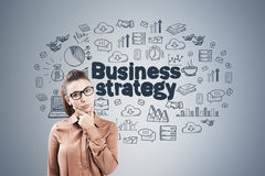 Woman in beige and business strategy Stock Image