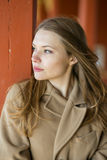 Woman in beige coat with confident face Royalty Free Stock Photos