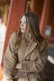 Woman in beige coat with long hairs Stock Image