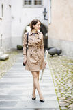 Woman at beige coat on narrow street pasaage Stock Images