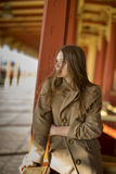 Woman in beige coat sees coming train Stock Photography