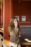 Woman in beige coat warming her nose Royalty Free Stock Photos