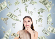 Woman in beige and dollar rain Royalty Free Stock Images