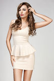 Woman in beige dress Royalty Free Stock Image