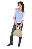 Woman with a beige handbag Royalty Free Stock Photography