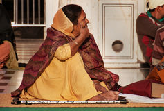Woman in beige saree in Golden Temple. Amritsar. India Stock Image