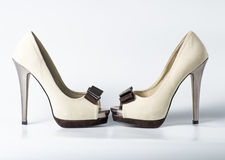 Woman beige shoes on white. Background Stock Image