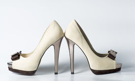 Woman beige shoes on white. Background Stock Photos