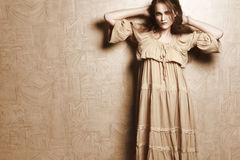 Woman in beige vintage dress Royalty Free Stock Images
