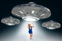 Woman being abducted by UFO - alien abduction concept. Woman being abducted by UFO - concept of alien abduction Stock Illustration