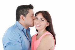 Woman being affectionately kissed. Close-up portrait of women being affectionately kissed by her husband Stock Photos