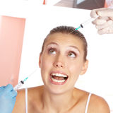 Woman being afraid of needles Royalty Free Stock Photography