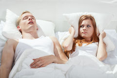 Woman being angry on snoring boyfriend Royalty Free Stock Images