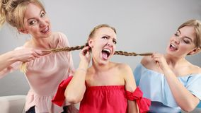 Woman being bullied by two females Stock Photography