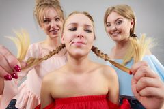 Woman being bullied by two females Royalty Free Stock Photography