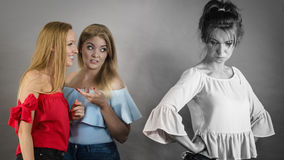 Woman being bullied by two females Royalty Free Stock Image