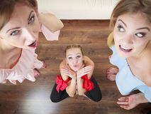 Woman being bullied by two females Royalty Free Stock Images