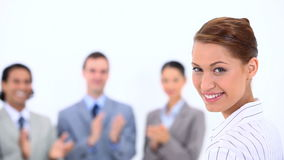Woman being congratulated by her colleagues Royalty Free Stock Photo