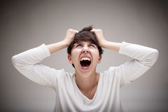 Woman being enraged and seeing red Royalty Free Stock Photos