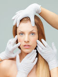 Woman being examinated plastic surgeons' hands Stock Photo