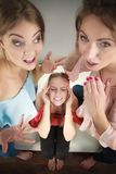 Woman being gossiped by two. Woman being gossiped bullied by two female friends. Friendship difficulties, rivaly and envy problems Royalty Free Stock Image
