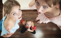 Woman being gossiped by two. Woman being gossiped bullied by two female friends. Friendship difficulties, rivaly and envy problems Stock Images