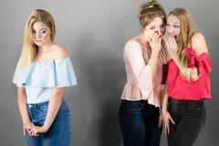 Woman being gossiped by two females royalty free stock photo