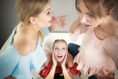 Woman being gossiped by two stock photography