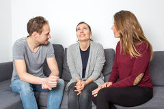 Woman being happy between friends Royalty Free Stock Image