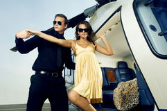 A woman being helped from a helicopter Royalty Free Stock Photos