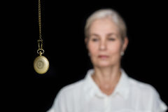 Woman being hypnotized with pendulum Royalty Free Stock Images