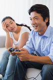 Woman being ignored by boyfriend playing video games Royalty Free Stock Images