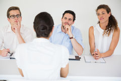 Woman being interviewed by business people Stock Images