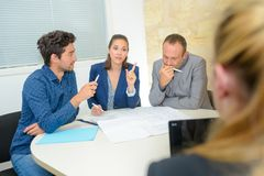 Woman being interviewed by three people royalty free stock images