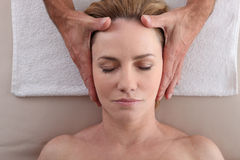 Woman being massaged Royalty Free Stock Images