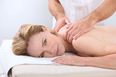 Woman being massaged Stock Photo