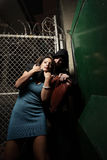 Woman being mugged. In a dark alley stock photography